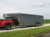 "2001' Trailmann 6'8"" x 24' Stock Trailer. 2- 7000#"