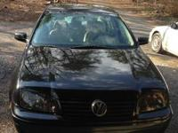 2001 VW Jetta.. Black with tan leather seats, sunroof,