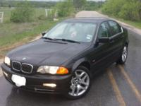 She's a black with gray leather interior 330xi. XI