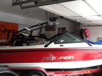Red 2001 Ski Centurion for sale. Wake tower with 4