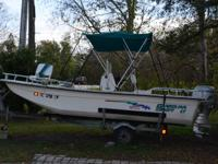 17 foot 2002 center console Carolina Skiff with