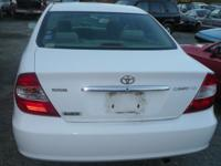 Selling in parts ONLY:. 2002 Toyota Camry LE White/Tan
