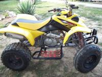 2002 4oo EX honda 4 wheeler yellow and black. It had a