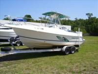 The Aquasport 225 Osprey features a rugged hull design,