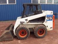 FOR SALE 2002 BOBCAT 763 SKID STEER WITH AN OPEN CAB