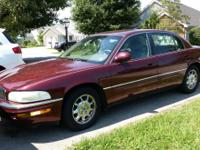 Maroon w/tan leather interior.  122,326 miles.