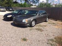 Options:  2002 Cadillac Deville Base 4Dr Sedan|Tan|Wow