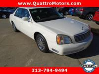 Low miles. Grand and graceful, this 2002 Cadillac