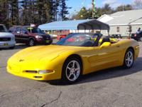 Bright yellow with black lether interior. This Vette