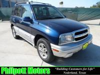 Options Included: N/A2002 Chevy Tracker, blue with gray