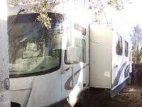 This 35' Coachmen needs interior work. The cabinets are