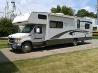 2002 Coachmen Santara Class C. This 31.5 foot RV is in