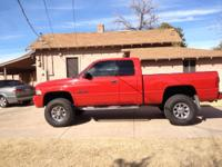 I AM SELLING MY 2002 DODGE 4X4 EXTENDED CAB SHORT BED