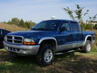 SLT trim. Edmunds Editors' Most Wanted Small Crew Cab