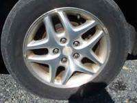 4 2002 Dodge Intrepid 5 Lug rims with tires. Tire size