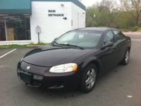 This is a very well kept Dodge Stratus that looks and