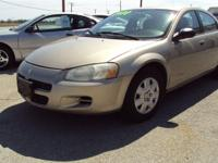 Nice mid-size 4 door car with a 4 cylinder motor and an