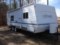 The pre-enjoyed 2002 Dutchmen Lite Travel Trailer Model