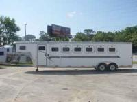 2002 Exiss (6) horse slant load trailer with a 5'