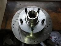 I HAVE BRAND NEW IN BOXES 2 DRILLED AND SLOTTED ROTORS,