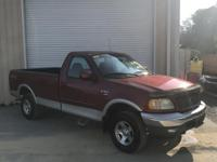 Clean CARFAX. Red 2002 Ford F-150 XLT 4WD 5-Speed