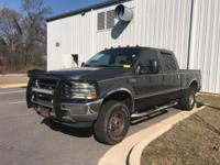Lariat trim. Leather Seats, Running Boards, CD Player,