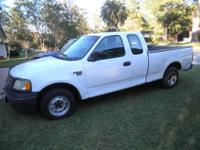 2002 Ford F 150 4 door super cab. Cold AC Auto Trans