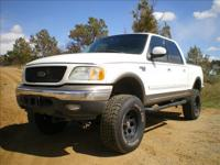 Options Included: 4 Door, Crew Cab, Off Road Package,