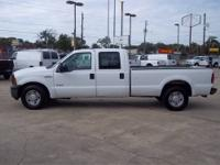 You are looking at a 2002 Ford F350 Crew Cab Dully 4X4