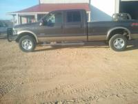 This is a 2002 Ford F350 Dually 4 door diesel. It has