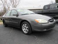 2002 Ford Taurus SE Gray four door. Great Running car,