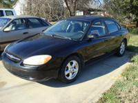 For sale is this 2002 Ford Taurus SE. This car is black