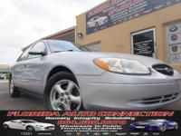 **LUXURY AT WHOLESALE PRICE** This 2002 Ford Taurus is