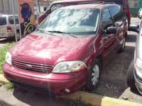 For sale is a red, 2002 Ford Windstar LX mini van with