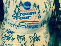 Autographed 2002 men's frozen four hat and bobble head.