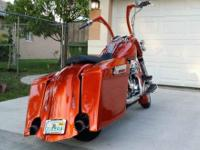 THIS IS A 2002 HARLEY DAVIDSON ROAD KING BAGGER.