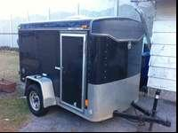 This is a black 2002 haulmark 5x8 utility trailer I am
