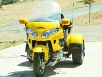 A beautiful highly visible yellow 2002 Honda GL1800