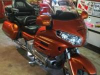 Sunburst pearl orange. Has armrest, highway pegs,
