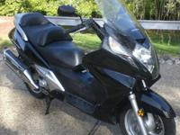 For sale is a 2002 Honda Silverwing 600cc scooter that