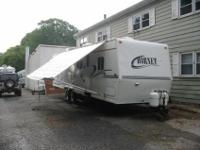 This is a 2002 Hornet by Keystone 32 Travel Trailer. It