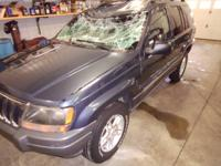 2002 Jeep Grand Cherokee...rolled over.  Motor and