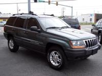Options Included: Front & Rear Cup Holders, Cargo Net,