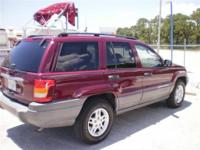 The standard features of the Laredo include 4.0L I-6