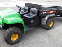 2002 John Deere 4x2 Gator and Trailer. 192.7 Original