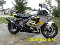 THIS IS A 2002 KAWASAKI NINJA ZX7-R. IT HAS ABOUT