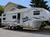 2002 Keystone Cougar. This 30 Foot Cougar 5th Wheel is