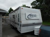 27 ft. travel trailer. A rear queen bed and a futon