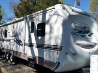 This 32' Montana travel trailer by Keystone is