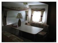 Sleeps 6, Queen Size Bed, Dinette & & Couch transform.
